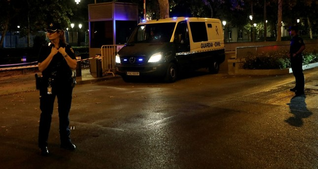A Spanish Civil Guard van carrying the leaders of two pro-independence groups leaves the High Court in Madrid, Oct. 16.