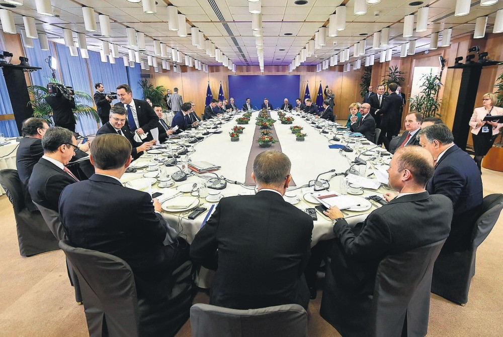 European Union heads of state attend a breakfast meeting at an EU summit in Brussels, Friday, Dec. 15.