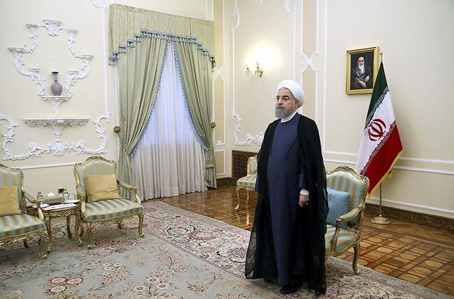 Iranian President Hassan Rouhani waits to welcome European Union foreign policy chief Federica Mogherini at the presidenial office in Tehran, Iran. (AP Photo)