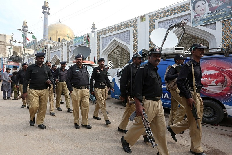 Policemen gather outside the tomb of Sufi saint Syed Usman Marwandi, also known as the Lal Shahbaz Qalandar shrine, after Thursday's suicide blast in Sehwan Sharif, Pakistan's southern Sindh province, Feb. 17, 2017.