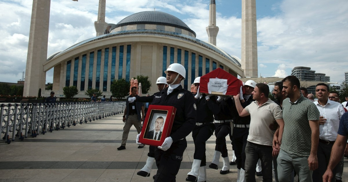 A police honor guard carries the coffin of Osman Ku00f6se, a 38-year-old Turkish diplomat killed in Iraq, before his funeral prayers in Ankara, Turkey, July 18, 2019.