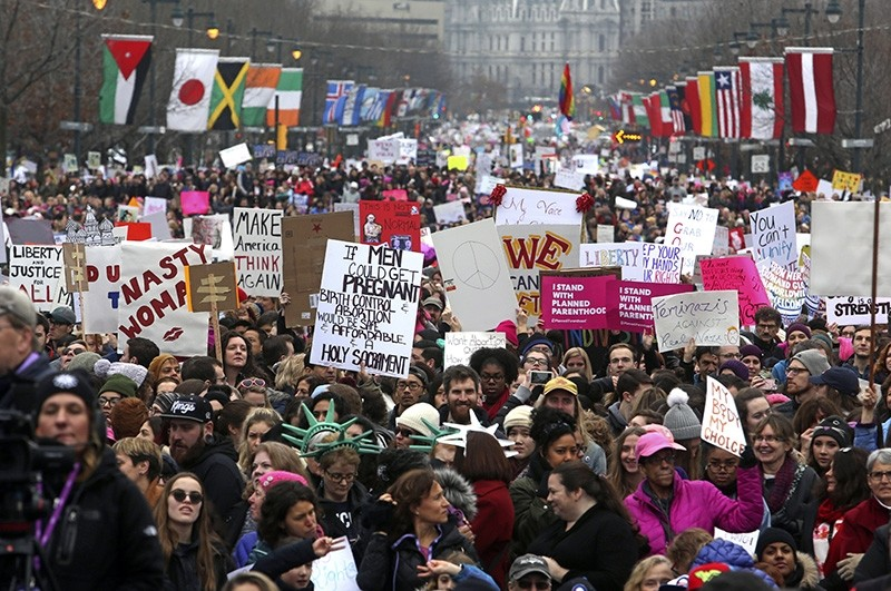 In this Jan. 21, 2017, file photo, thousands of protesters, on the day after Republican President Donald Trump's inauguration, participate in a women's march on the Benjamin Franklin Parkway in Philadelphia. (AP Photo)