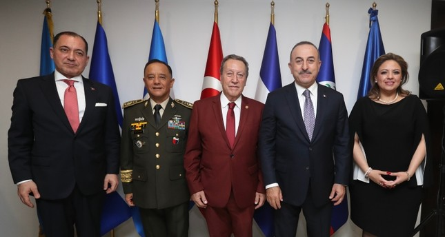 وزير الخارجية مولود تشاوش أوغلو في حفل افتتاح المبنى الجديد لسفارة بلاده في غواتيمالا (الأناضول)