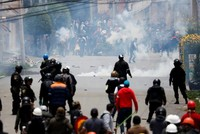 Interim president-in-waiting vows to call new vote as protests continue in Bolivia
