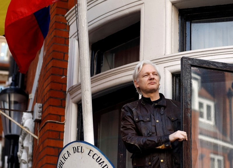 In this May 19, 2017 file photo, WikiLeaks founder Julian Assange greets supporters from a balcony of the Ecuadorian Embassy in London. (AP Photo)