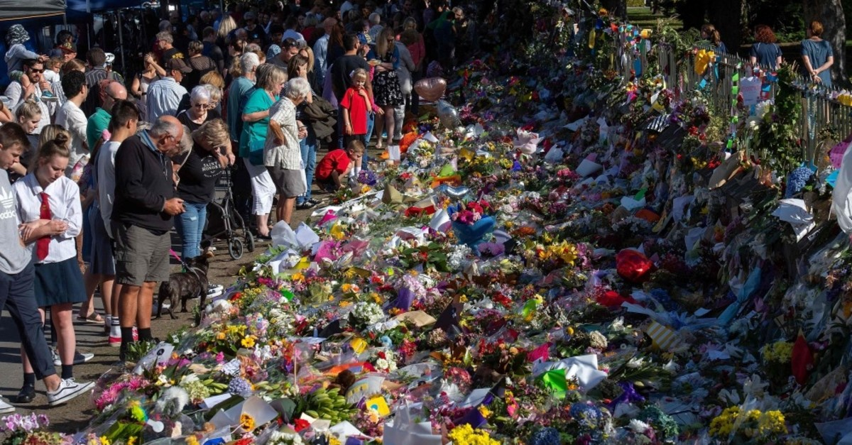 Floral tributes to those who were gunned down at the two mosques are seen against a wall bordering the Botanical Garden in Christchurch, New Zealand, March 19, 2019.