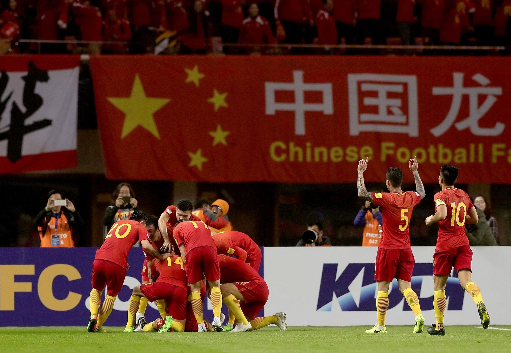 Chinese players celebrate after Yu Dabao scored during the World Cup football qualifying match against South Korea in Changsha, Chinau2019s central Hunan province.