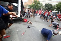 Philippine police rams van into anti-US protesters in front of Manila embassy
