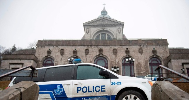 Police provide security at Saint Joseph's Oratory in Montreal on March 22, 2019, after Catholic Priest Claude Grou was stabbed during a livestreamed morning mass (AFP Photo)