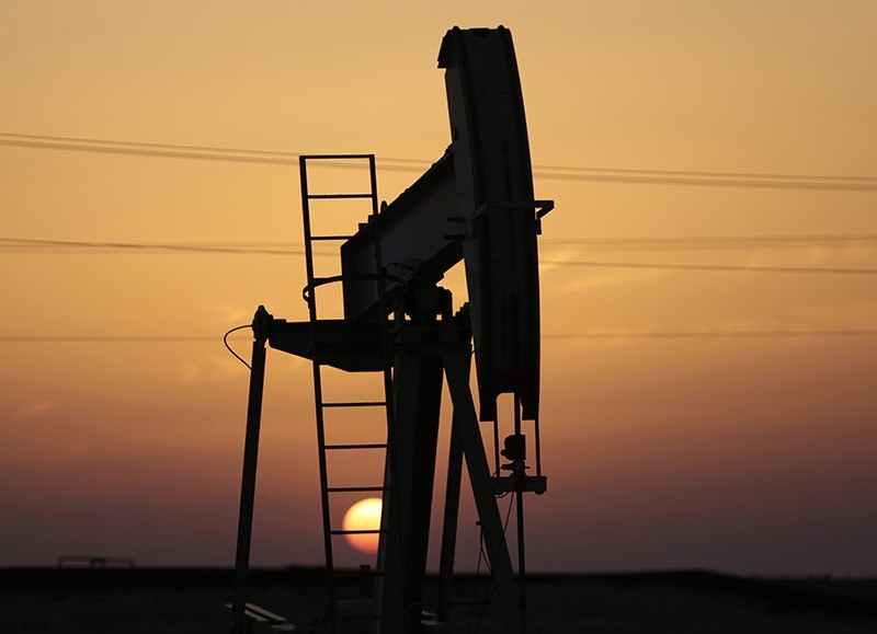 In this April 16, 2016 file photo, an oil pump works at sunset in the desert oil fields of Sakhir, Bahrain. (AP Photo)