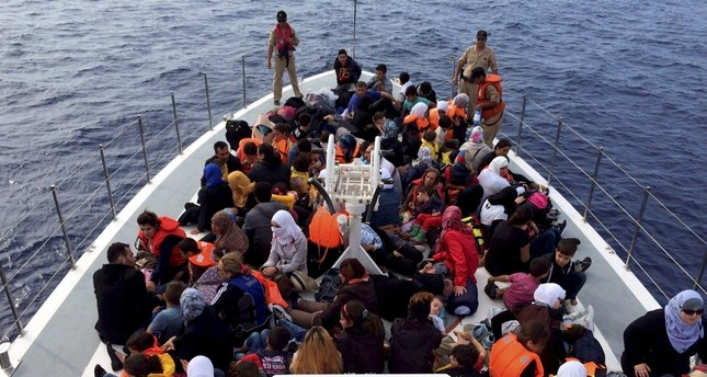 Migrants on a Turkish Coast Guard boat that intercepted and rescued them from potential death. Migrant numbers rose again in the Aegean Sea after a brief drop following a deal between European Union and Turkey.