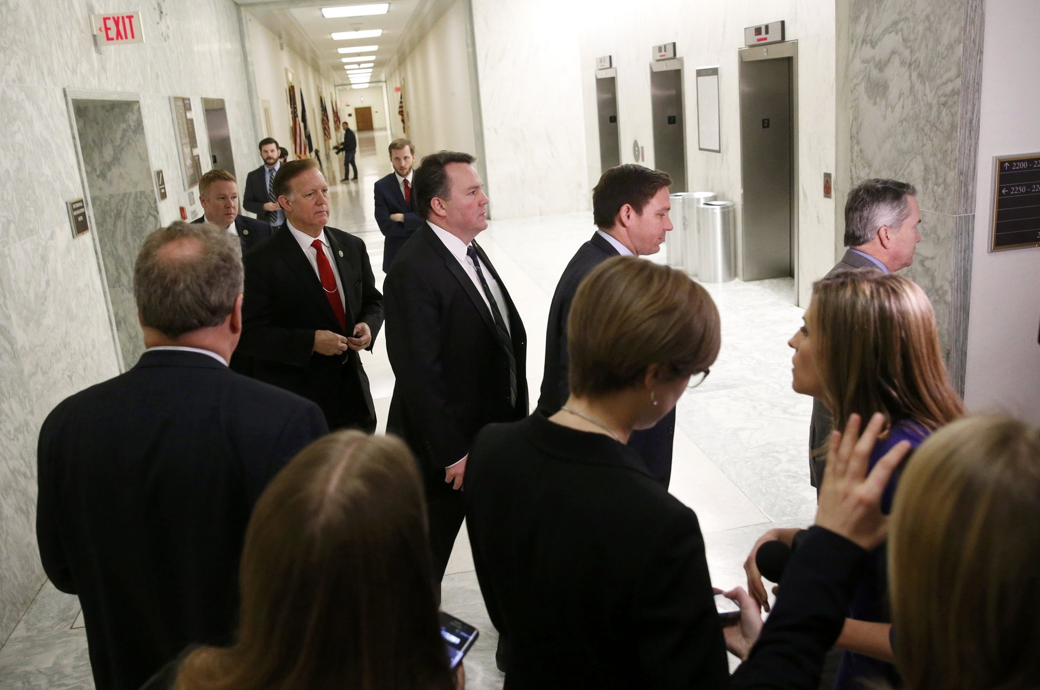 House Freedom Caucus members return to a meeting after their trip to the White House to meet with Trump about the health care bill. (Reuters Photo)