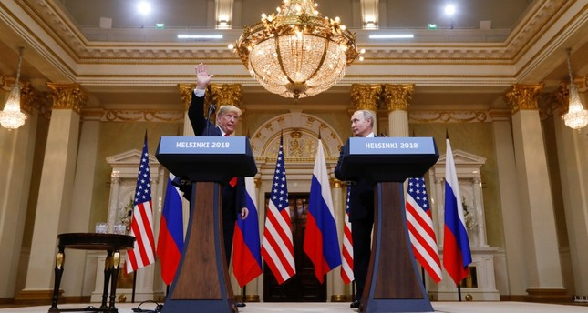 U.S. President Donald Trump (L) waves after a joint news conference with Russia's President Vladimir Putin following their meeting in Helsinki, Finland, July 16, 2018.