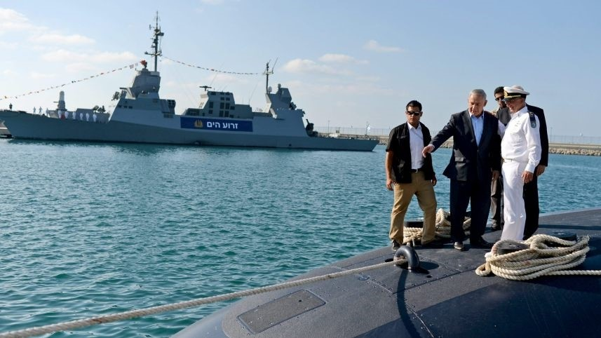 Photo released by the Israeli Government Press Office shows PM Netanyahu, President Rivlin and Navy Commander Major Gen. Rothberg inspecting a new submarine in March, 2017.