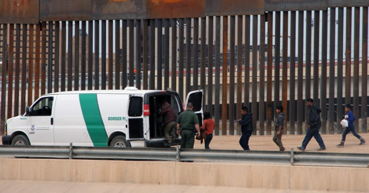 Central American migrants board a US Customs and Border Patrol van after being detained at the border wall in Ciudad Juarez, Chihuahua state, Mexico, on May 7, 2019. (AFP Photo)