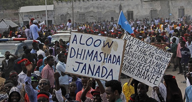 Somali protesters march in solidarity with the victims of Saturday's bombing, defying al-Shabaab. (AP Photo)