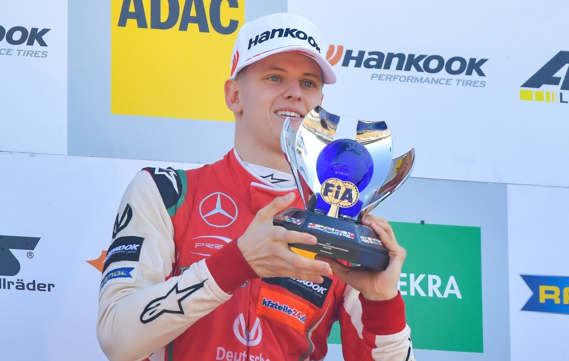 Mick  Schumacher raises the trophy as overall winner in FIA Formula 3 European Championships at the Hockenheim race track, Germany, Oct. 14.