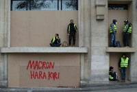 All eyes on Macron after a month of yellow vest riots