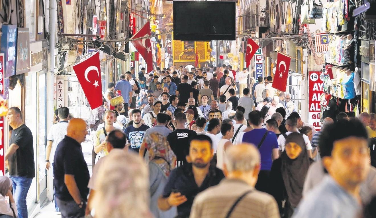 People walk inside Istanbulu2019s Grand Bazaar, Friday, Aug. 17, 2018.