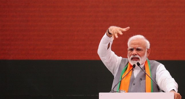Indian Prime Minister Narendra Modi gestures at an event to present the Bharatiya Janata Party (BJP) election manifesto in New Delhi on April 8, 2019. (AFP Photo)