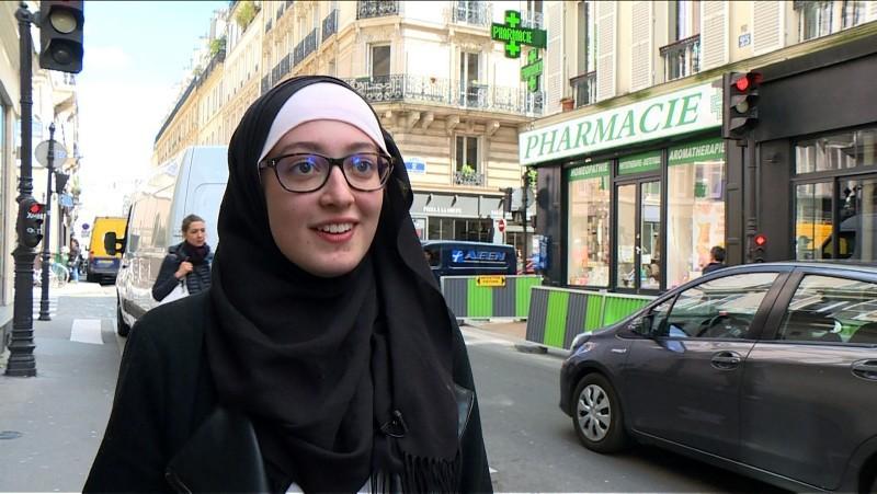 In this video grab image taken on May 2, 2018, Union President at Paris-Sorbonne University (Paris IV) Maryam Pougetoux walks down a street in Paris (AFP Photo)