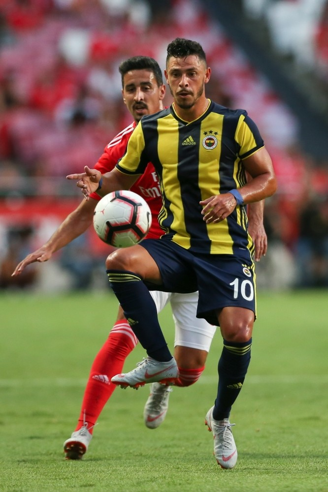 Benfica's player, Andre Almeida (L), in action against Fenerbahu00e7e player, Giuliano, during their Champions League third qualifying round first leg match in Lisbon, Aug. 7.