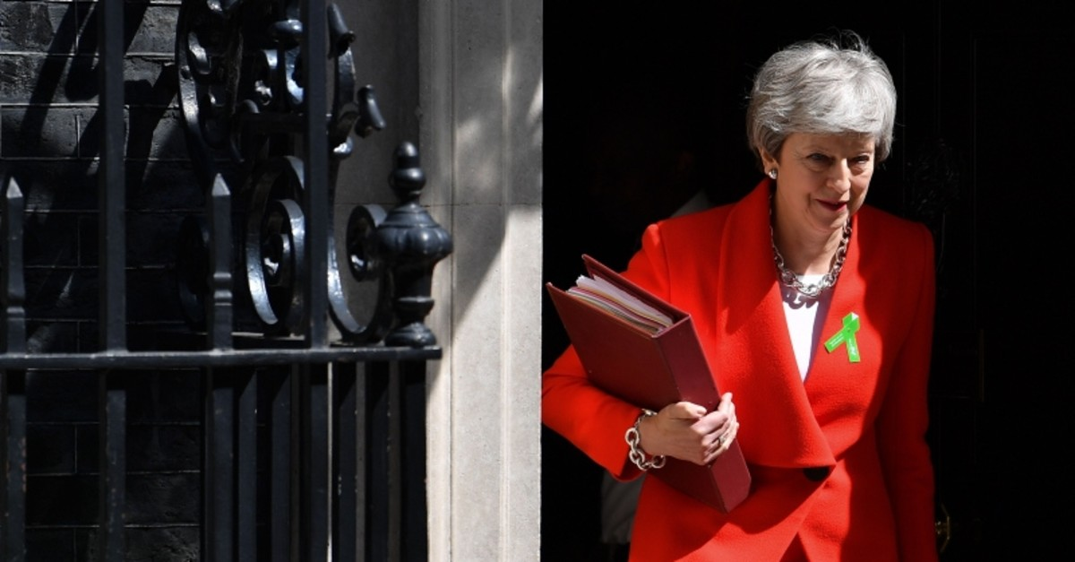 Britain's Prime Minister Theresa May leaves 10 Downing Street in London on May 15, 2019, ahead of the weekly Prime Minister's Questions (PMQs) question and answer session in the House of Commons.