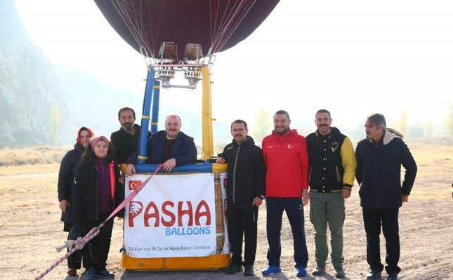 Industry and Technology Minister Mustafa Varank flew over the Cappadocia skyline, riding the first domestically produced hot air balloon, Nev?ehir, Nov. 18, 2019. (AA Photo)