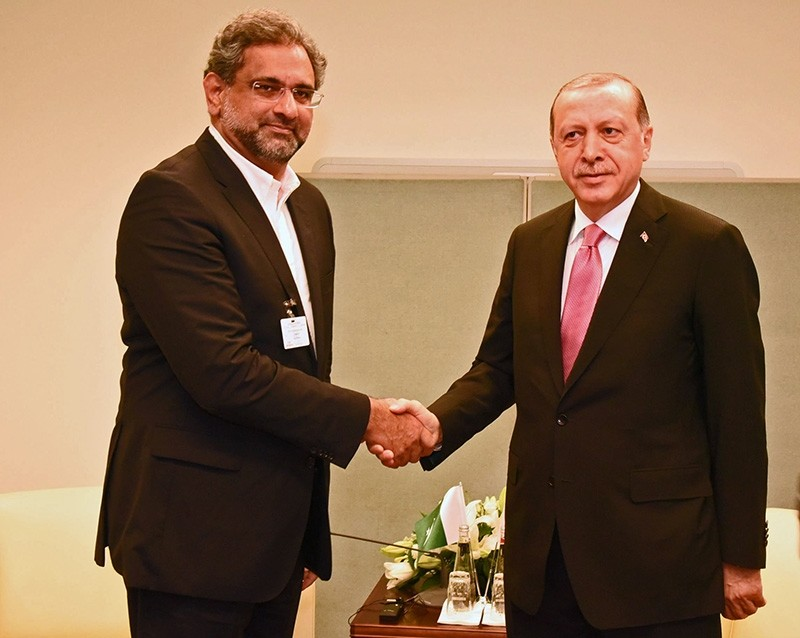 In this file photo dated Oct. 20, 2017, President Recep Tayyip Erdou011fan (R) shakes hands with Pakistan's Prime Minister Shahid Khaqan Abbasi.