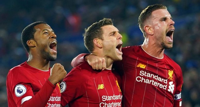 Liverpool players celebrate after scoring a penalty against Leicester City, Liverpool, Dec. 26, 2019 EPA Photo