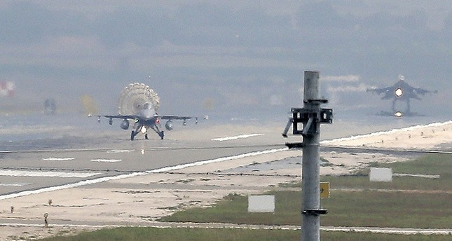Turkish Air Force fighter planes land at İncirlik Air Base, on the outskirts of the city of Adana, southern Turkey, July 30, 2015. (AP Photo)
