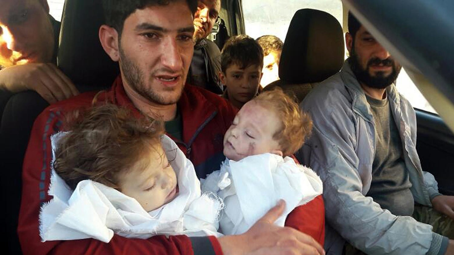 In this picture taken on Tuesday April 4, 2017, Abdul-Hamid Alyousef, 29, holds his twin babies who were killed during an Assad regime chemical weapons attack, in Khan Sheikhoun, Syria. (AP Photo)