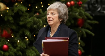 May survives confidence vote amid Brexit chaos