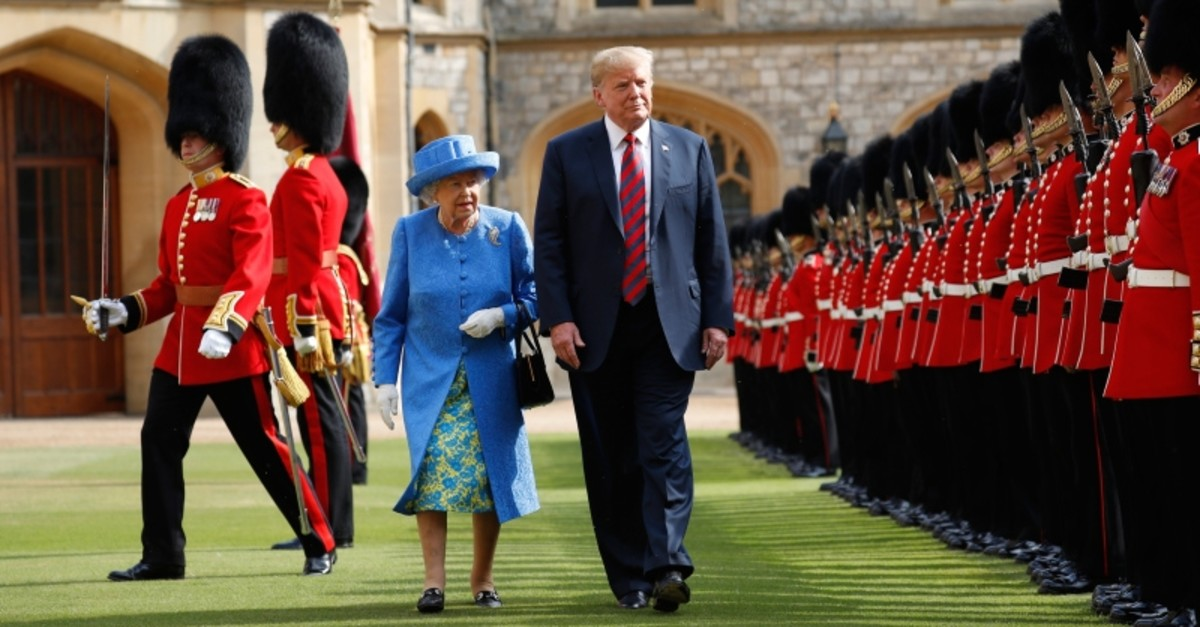 In this Friday, July 13, 2018 file photo, U.S. President Donald Trump and Britain's Queen Elizabeth inspects the Guard of Honour at Windsor Castle in Windsor, England. (AP Photo)