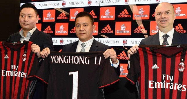 Head of Rossoneri Sport Investment Lux, Chinese businessman and AC Milan's new owner, Yonghong Li (C) poses with Italian businessman Marco Fassone (R) and RSIL representative David Han Li (L) during a press conference, on Friday, in Milan. (AFP Photo