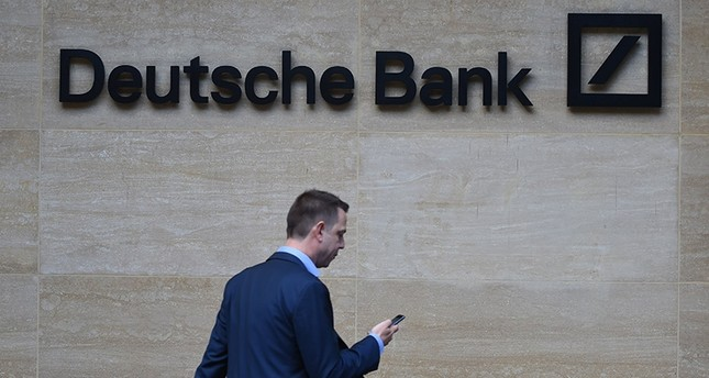 A man walks past by the British headquarters of the German Deutsche Bank in London, Britain, 30 September 2016 (re-issued on 29 January 2018). (EPA Photo)