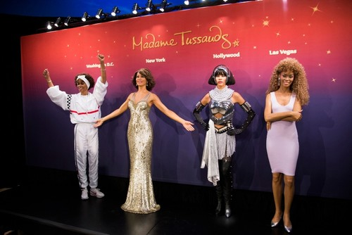 In this Feb. 7, 2013 file photo, Whitney Houston wax figures are unveiled at Madame Tussauds in New York. (AP Photo)