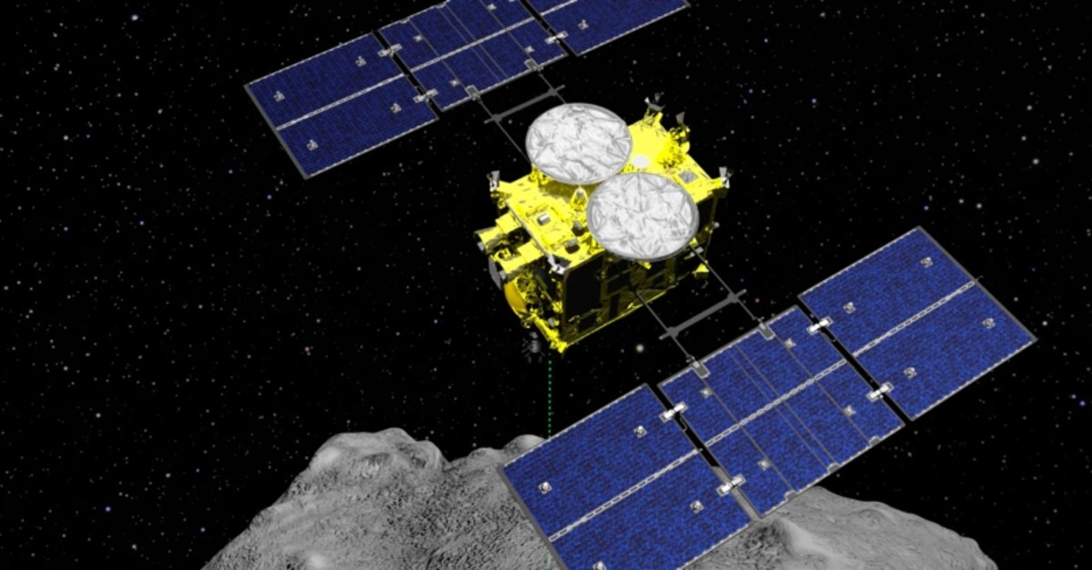 In this computer graphics image released by the Japan Aerospace Exploration Agency (JAXA), the Hayabusa2 spacecraft is seen above on the asteroid Ryugu. (AP Photo)