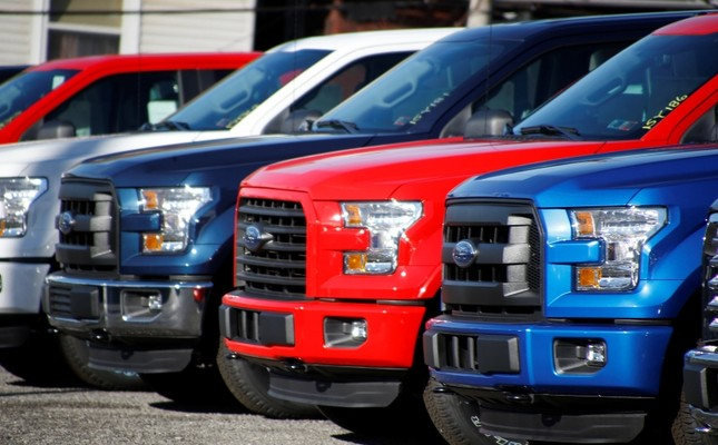 In this Nov. 19, 2015, file photo a row of 2015 Ford F-150 pickup trucks are parked on the sales lot at Butler County Ford in Butler, PA, U.S. (AP Photo)
