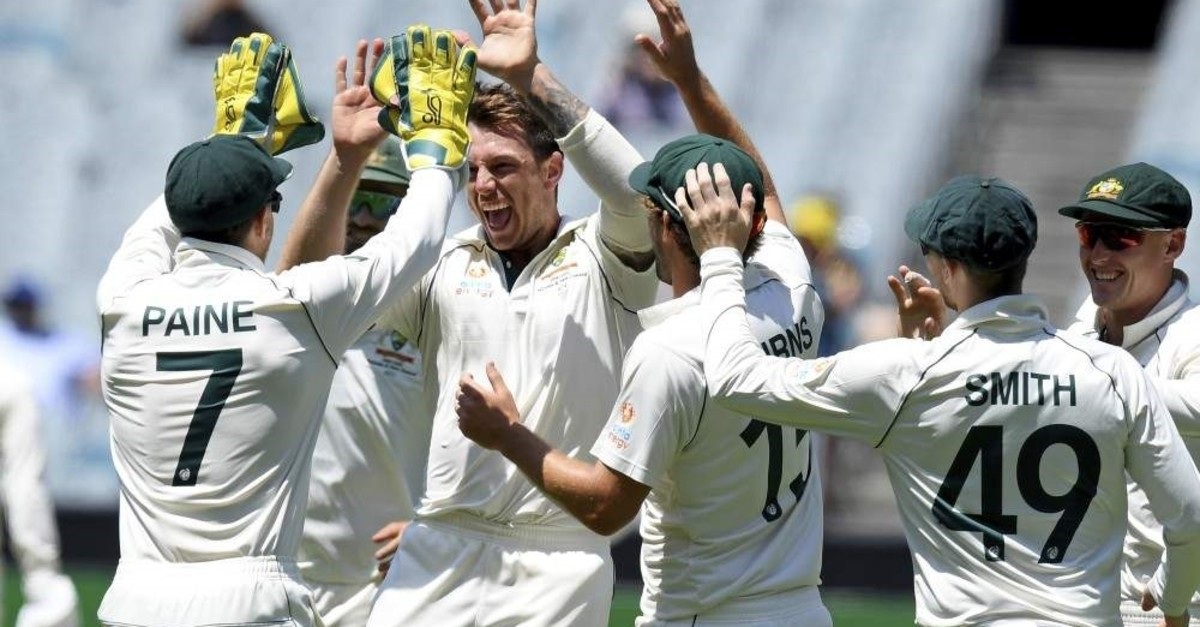 Pattinson (2nd L) celebrates with teammates after capturing the wicket of New Zealand's Ross Taylor during their cricket Test match in Melbourne, Australia, Dec. 29, 2019. (AP Photo)