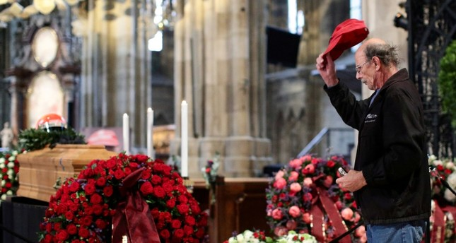 A mourner pays his respects at the coffin of Austrian motor racing great Niki Lauda during his funeral at St Stephen's cathedral in Vienna, Austria May 29, 2019. (Reuters Photo)