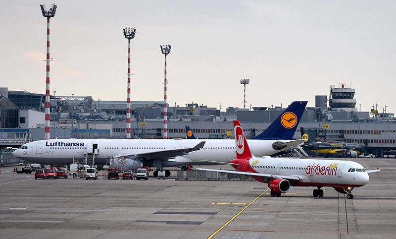 An airplane operated by German airline Air Berlin rolls on the tarmac past a Lufthansa plane on Oct. 10, 2017 at Duesseldorf Airport, western Germany. (AFP Photo)