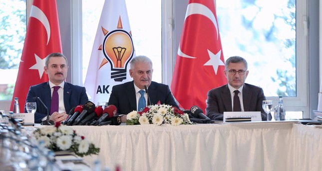 Parliament Speaker Binali Yıldırım (C), who is the AK Party's Istanbul mayoral candidate for the March 31 local elections, speaks at a press conference in Istanbul, yesterday.