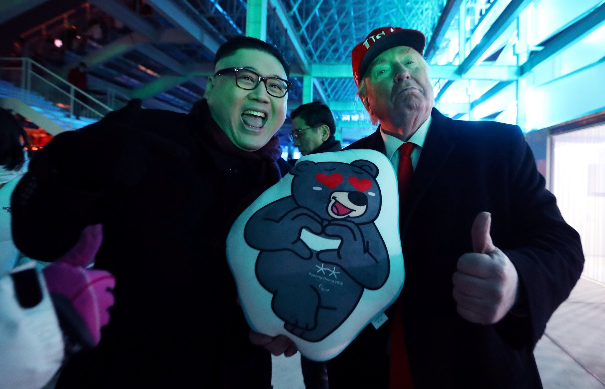 North Korean leader Kim Jong Un and U.S. President Donald Trump impersonators pose at the main stadium of the Pyeongchang Winter Olympic Games, Feb. 5.