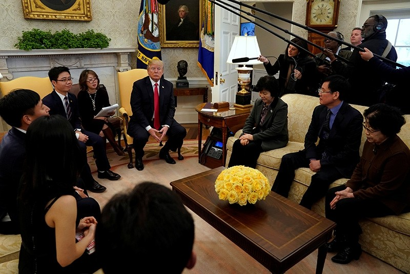 U.S. President Donald Trump meets with North Korean defectors in the Oval Office of the White House in Washington, U.S., February 2, 2018. (Reuters Photo)