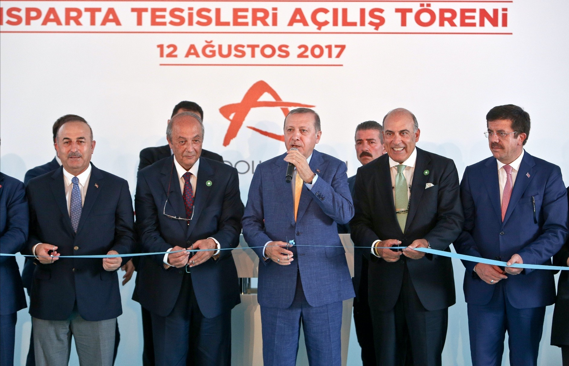 President Erdou011fan, third from right, participated in the opening ceremony of two new beverage facilities belonging to Anadolu Group.