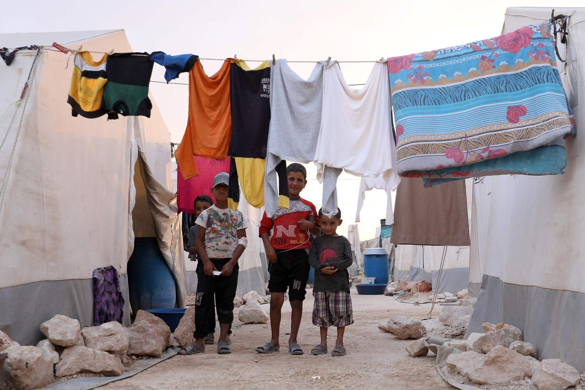 Displaced Syrian children pose for a photograph in a refugee camp near the Turkish-Syrian border, Sept. 13.
