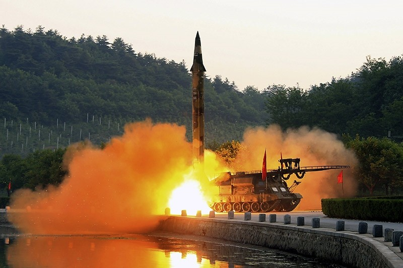 An undated photo made available by the KCNA, the state news agency of North Korea, shows the test-fire of a ballistic rocket equipped with precision guidance system, at an undisclosed location in North Korea. (EPA Photo)