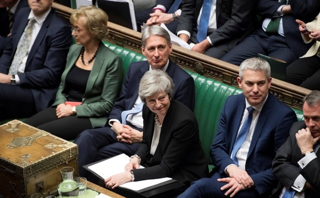 Prime Minister Theresa May attends a debate on Brexit 'plan B' in parliament, in London, Britain, January 29, 2019. Text in documents removed at source. UK Parliament/Jessica Taylor/Handout via REUTERS