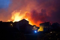 At least 10,000 people were evacuated overnight after a new wild fire broke out in southern France, which was already battling massive blazes that have consumed swathes of forest, authorities said...